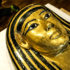 golden face of mummy's sarcophagus