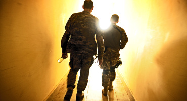 two soldiers walking into the light
