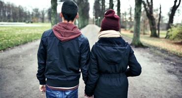 teen couple walking away