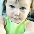 toddler girl with arms outstretched