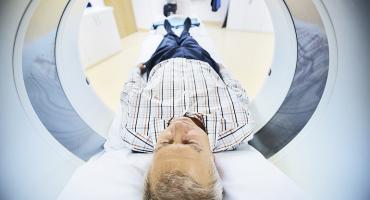 older man in a CT scanner