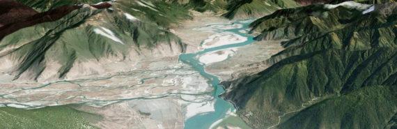 This Google Earth image looks down the Yarlung Tsangpo Valley towards the Namche Barwa (right) and Gyala Peri massifs (left). (Credit: Map data: Google, Mapabc.com, DigitalGlobe, and Cnes/Spot Image)