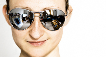 young woman wears aviator sunglasses