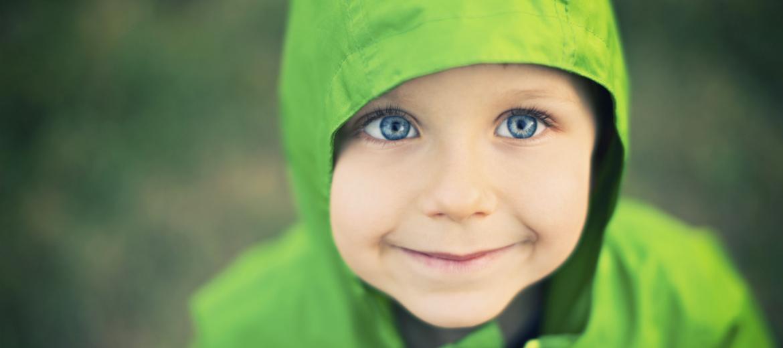 little boy in a green jacket