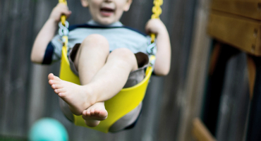 young boy on a swing