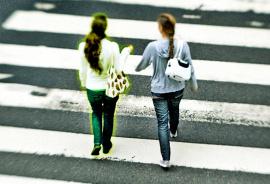 two women in crosswalk