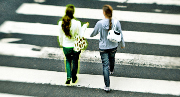two women in crosswalk