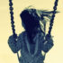 filtered image of kid on swing