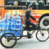 man delivers water on a bicycle in Shanghai