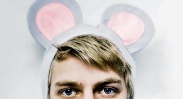 blonde man wears mouse ears
