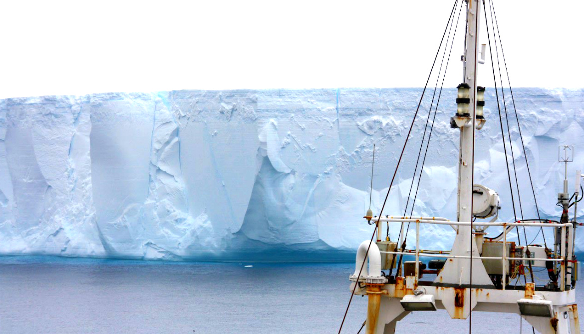 The RRS James Clark Ross in front of an iceberg in the Weddell Sea.