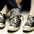overlapping teen feet in Chucks
