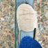 slippered foot balances on beam