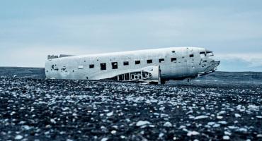 crashed plane on black ground
