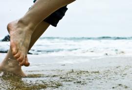feet in ocean at beach