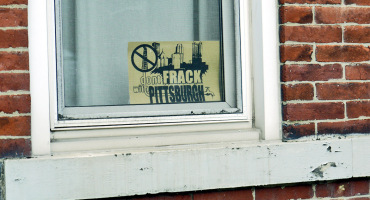 Fracking protest sign in a window of a house