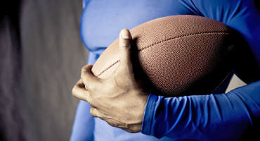 man holds a football
