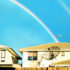 rainbow above two houses