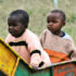 two Kenyan children play on slide
