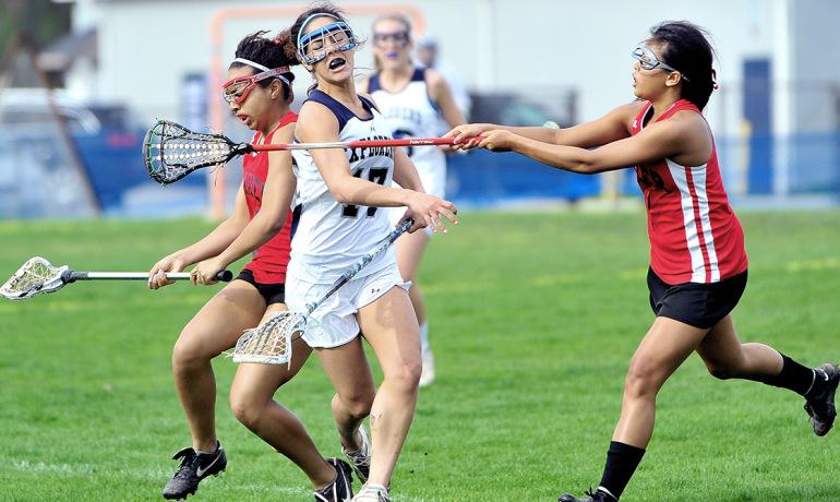 teenagers play lacrosse
