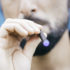 man smokes an electronic cigarette