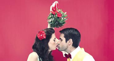 couple kisses under mistletoe