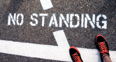 standing on no standing sign