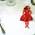 paperdoll on table with silverware