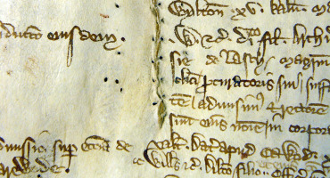 sewn repair in parchment