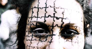 woman with puzzle pattern on face