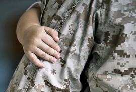 returning Marine holds son