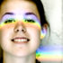 woman with rainbow across face
