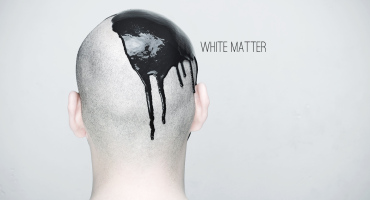 man with black paint on his shaved head