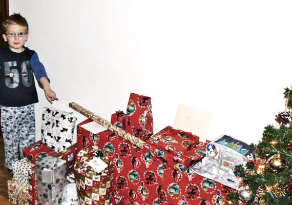kid points at christmas presents