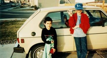1980s-era photo of kids standing beside a car
