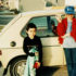 1980s-era photo of kids standing beside a car