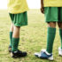 legs of two boys playing soccer