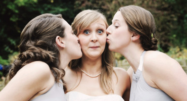 bridesmaids kiss bride on cheek