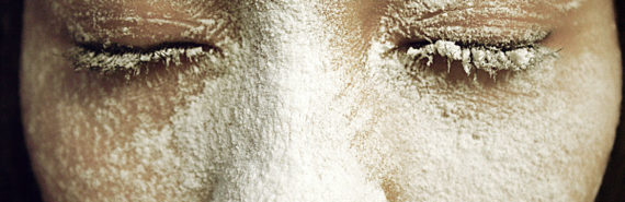 woman's face covered in white powder