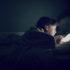 girl views a tablet at night