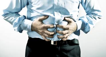 inflammatory bowel disease - man clutches gut