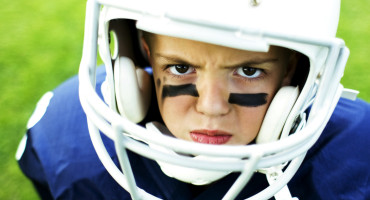 young child in an American football uniform