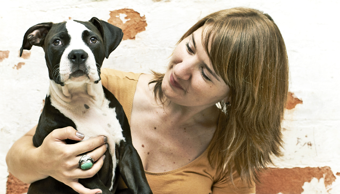 woman gazes at her puppy