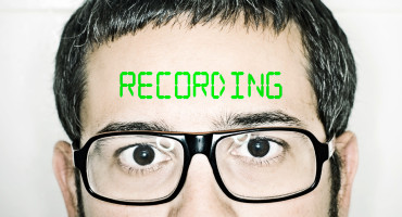 "man with ""recording"" on forehead"
