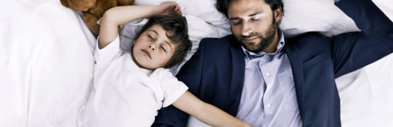 boy and dad sleep with laptop
