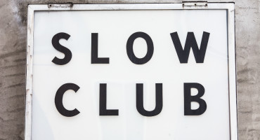 """sign reads"""" slow club"""""""