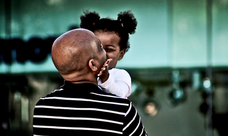 little girl is nice to her dad