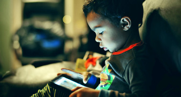 little boy looks at screen