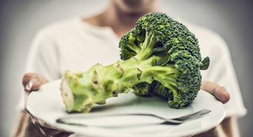 man offers broccoli diet on plate