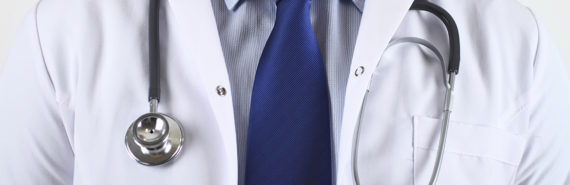 doctor in a suit and white coat